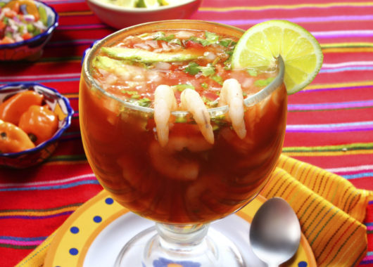 Cocktail of shrimps seafood mexican style chili sauce